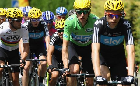 The SKY Procycling Team keep on eye on team leader Bradley Wiggins of Great Britain during the 2012 Tour de France.