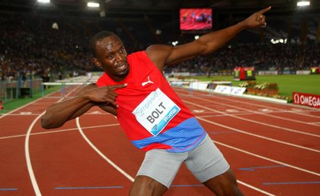 Usain Bolt celebrates after winning the 100m men's race at the IAAF Compeed Golden Gala at Stadio Olimpico on May 31.