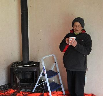 HOT DRINK: Aera Kani with a long awaited cup of coffee. She was boiling the jug when a chimney fire broke out in her home yesterday morning