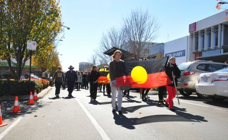 Leading the NAIDOC Week march are Tasi Seckold (left) and Kaniesha Woodbridge.