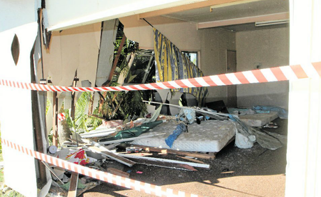 A woman narrowly escaped injury when a car crashed into this Mackay home, on Lynch St, East Mackay.
