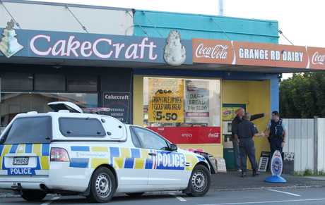 Police at the scene of the armed robbery at the Grange Rd Dairy in Otumoetai