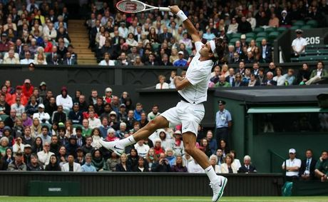 Roger Federer in action on day 13 of the Wimbledon Lawn Tennis Championships.