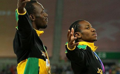 Usain Bolt and Yohan Blake of Jamaica pose with their gold medals during the medal ceremony for the men's 4x100 metres relay final during day nine of 13th IAAF World Athletics Championships on September 4, 2011.