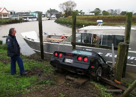 A Kaitaia police officer puzzles over yesterday's crash involving a classic Corvette and a boat moored in the Awanui River, while boat owner Craig Harrison wonders what almost hit him.
