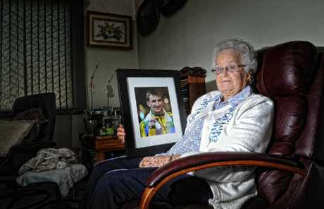 Rita Cowling of South Grafton with a picture of her grandson Michael Shelley - who has qualified to run in the Olympic marathon.
