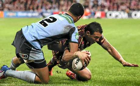 Queensland winger Darius Boyd plants the ball down to score against New South Wales in Brisbane last night.