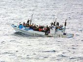 MORE than 130 illegal immigrants were intercepted in a boat in Australian waters east of Christmas Island as another 36 Sri Lankans were transferred to Nauru.