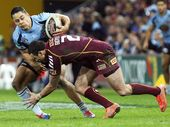 The Queensland Times photographer Claudia Baxter was at Suncorp Stadium on Wednesday night to capture all the action of the hard-fought battle won by Queensland.
