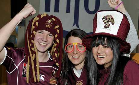 Queensland supporters (from left) Ben Burstow, Kasey Roser and Sarah Yin show their colours.