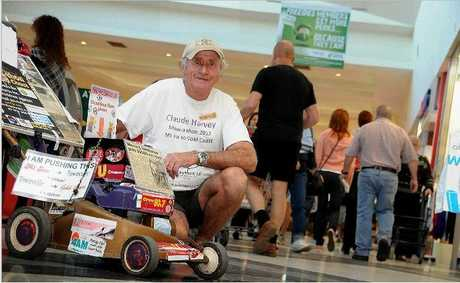 Claude Harvey is pushing his lawnmower from the Gold Coast to Mt Isa to raise money for Bravehearts and help save children from abuse.