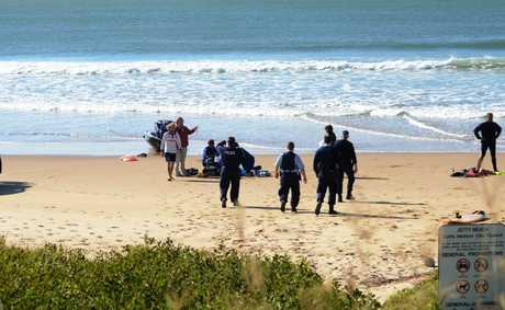 A man died after he suffered cardiac arrest while surfing with his sons on Jetty Beach this morning.