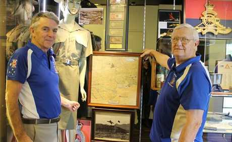 Graham Johnson and Rob Wareing working on one of the memorabilia cabinets at the Tewantin-Noosa RSL.