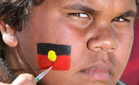 Kahdeem Murray visits the face painter at the NAIDOC Family Fun and Information Day.