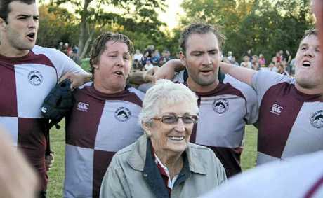 The Dolphins celebrate the A-grade win with Val Beakey.