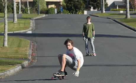 A Tauranga teenager prepares for a slide on Athfield Drive, Bethlehem, much to the distress of residents upset with the regular skateboarding. Photo / Joel Ford