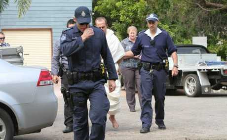 Police take a man into custody following a dramatic pursuit in Rockhampton.