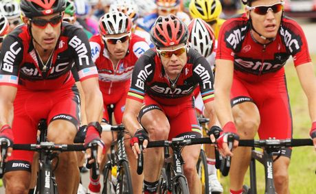Cadel Evans (centre) of Australia and the BMC Racing team rides in the peloton during stage three of the 2012 Tour de France from Orchies to Boulogne-sur-Mer.