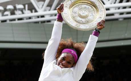Serena Williams of the USA jumps in the air with the winners trophy and celebrates after her Ladies' Singles final match against Agnieszka Radwanska of Poland on day twelve of the Wimbledon Lawn Tennis Championships at the All England Lawn Tennis and Croquet Club.