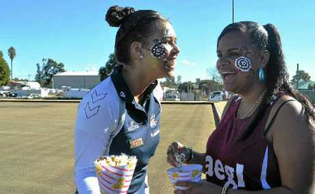 Bianca Charles and Jinnita Currie enjoy yesterday's NAIDOC celebrations at the Warwick East Bowls Club.