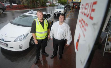 Taxi Marshall Dan Weston and Mackay Taxis GM Gary Button at the Wood Street Taxi Rank.