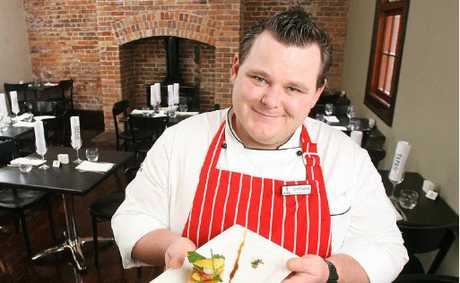 Stumps Hotel executive chef Darryl Bradshaw with one of the meals available at the newly opened hotel and tapas bar.