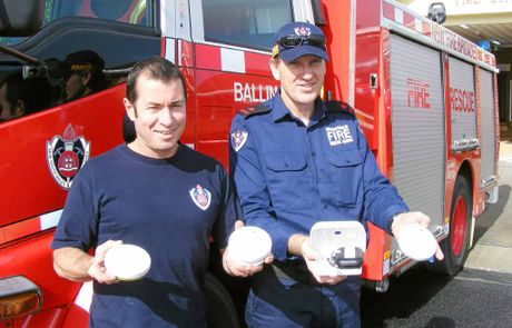 BE SAFE: Ballina retained firefighter Tony Savage and deputy captain Joel Peters are calling for people to check the batteries in their smoke alarms.