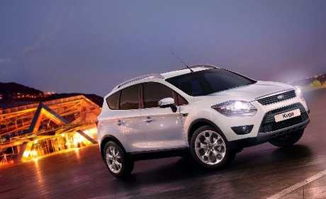 Ford Kuga. Ford president and CEO Alan Mulally says there is positive growth in the company.
