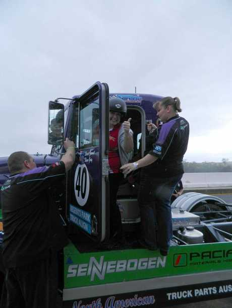 Big Rigs editor Carly Morrissey gets ready for the ride of her life in a racing truck.