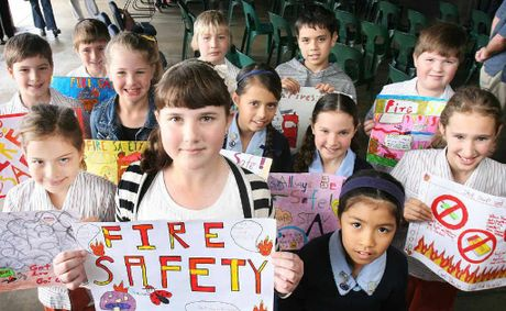 WORD PLAY: Fire poster competition winners (from left, at front) Poppy Wood (second), Mackenzie Fox (first) and Sara Encinas (third) help spread the safety message with other prize winners.
