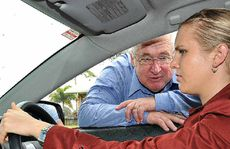 Mackay Driving School defensive driving instructor Wayne Bell appraises Daily Mercury journalist Andrea Davy's driving skills yesterday.
