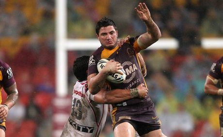 """No worries, I've got this"" Matt Gillett of the Broncos is tackled during the NRL Round 19 game between the Brisbane Broncos and the New Zealand Warriors at Suncorp Stadium"