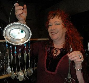 CUTLERY CREATIONS: Sandra Williams shows some of the wind chimes she makes.