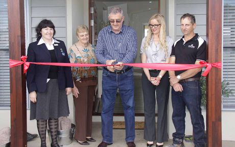 Gympie Mayor Ron Dyne (centre) cuts the ribbon to officially open Stirling Homes Queenslands new display home at Curra as councillor Rae Gate (left) Mayoress Dulcie Dyne and Stirling Homes Karen and Peter Bazzan look on.