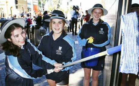 Ipswich Girls' Grammar School Year 10 students Charlotte Wilds, Breanna Moore and Georgia Humphries descended on Ipswich Mall with buckets and brooms.