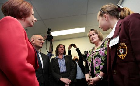 PM Julia Gillard meets with Lee Kenny and her daughter Hollie at the announcment for plans to construct a new cancer care centre at Springfield.
