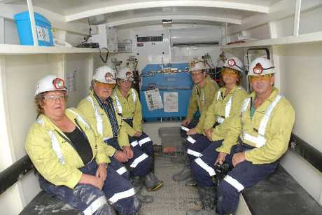Waihi mine staff take shelter in a six-man refuge chamber equipped with enough oxygen to last for 36 hours. This picture was taken during an exercise carried out by the company.