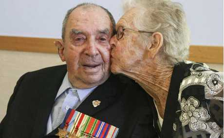 Clarence Valley war veteran Ken Barnier gets a kiss from his wife of 69 years, Kathleen, earlier this year. Ken died on Monday morning.