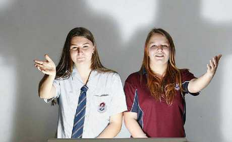 Ipswich High Year 11 students Sara Kajewski-Dicker (left) and Kayla Ashcroft, sign up for the speech contest.