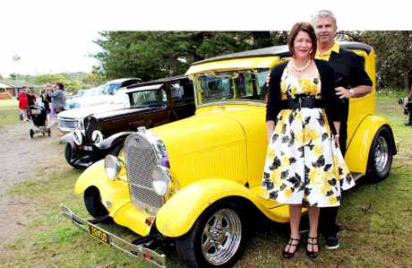 BRING A LITTLE SUNSHINE: Enthusiasts Michelle and Mark Heywood with their 1929 Ford Tudor.
