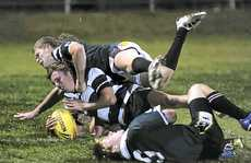Kierrenn Stewart barges over the line for Grafton High in the Daily Examiner Shield final at McKittrick Park last night. Photo: Adam Hourigan
