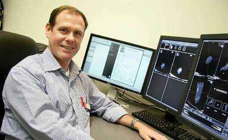Radiologist Dr Geoff Clark analyses a scan of a patient's foot at Rockhampton Regional Radiology.
