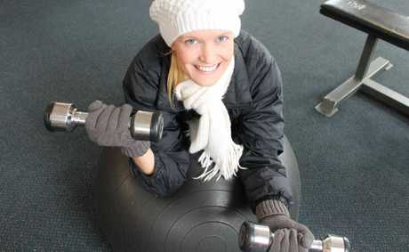 Voyage personal trainer Shelley Mayes says you don't need to rug up like this in winter, the gym is nice and toasty.