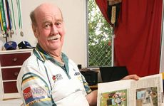 Local football historian Merv Gumbleton with his collection of scrapbooks from the past 30 years.