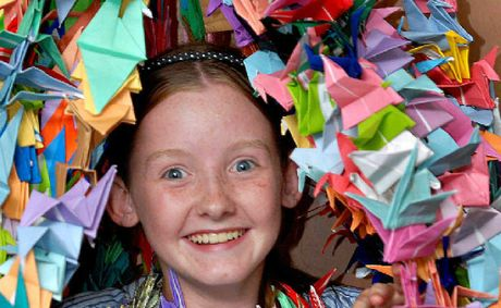 Shay Parker, 12, of Mirani, in 2007 covered with paper cranes.