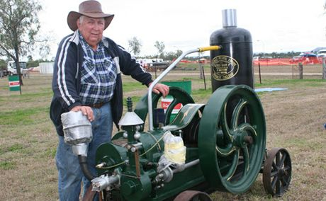 FULLY RESTORED: Alf Shand, Home Hill, member of the Burdekin MAchinery Preservation Society, the engine was made in England 5hp petrol engine really rare owned by Ray Blain from Mareeba had for two years and has been working on it for two years on and off.