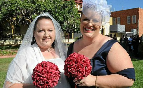 Dan and Erin MacKenzie will attend an equality rally in Toowoomba in the same wedding dresses they wore when they formalised their relationship with a same-sex civil union.