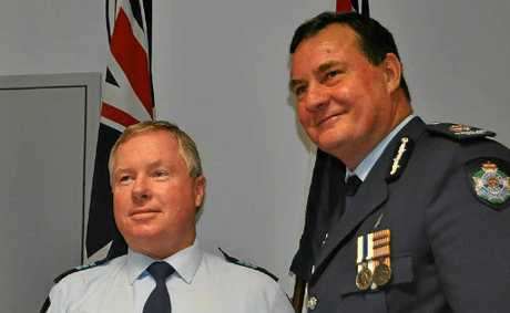 Southern Police Region Assistant Commissioner Paul Wilson (right) presents Sgt Guy Smidt with his award.