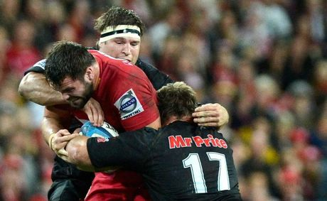 James Hanson of the Reds charges into the defence during the Super Rugby Qualifying Final between the Reds and the Sharks at Suncorp Stadium on July 21, 2012 in Brisbane, Australia. 
