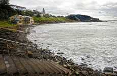 Water, water everywhere but not a grain of sand on Yamba Main Beach, here covered by high tide. 